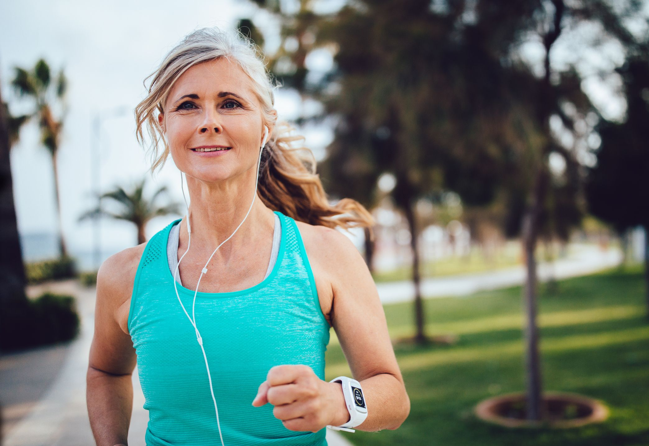 active-mature-woman-with-headphones-and-smartwatch-royalty-free