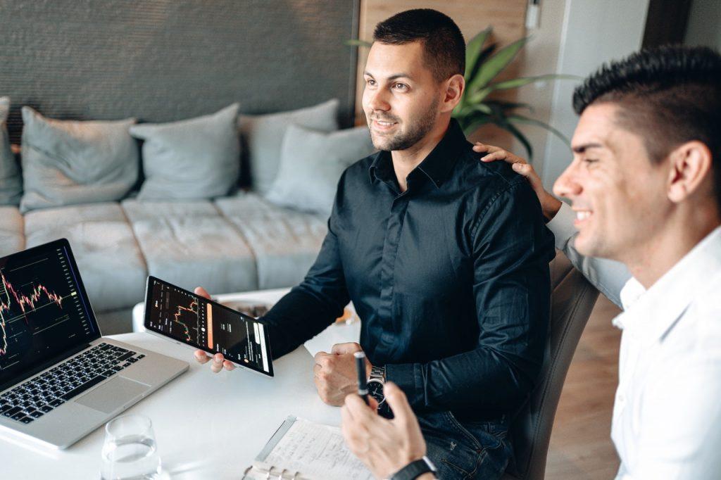 two men using digital marketing tools